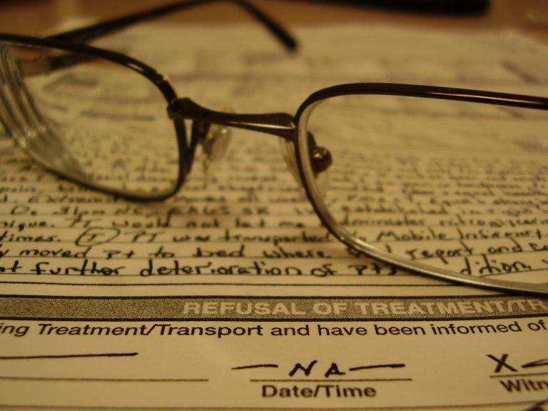glasses on documents
